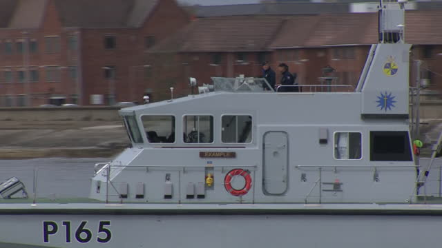 exterior shots of naval ships leaving portsmouth docks bound for jersey during a protest by french fisherman on 6 may 2021 in portsmouth, united... - 男漁師点の映像素材/bロール