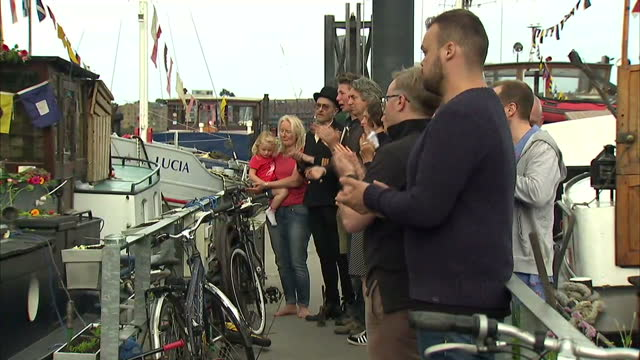 exterior shots of neighbours of jo cox blowing horns on their houseboats to mark the death of jo cox mp who was killed outside a library in birstall... - jo cox politician stock videos and b-roll footage