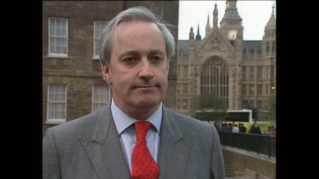 Exterior shots of Neil Hamilton walking through Westminster giving an interview on Abingdon Green on March 19 1997 in London England