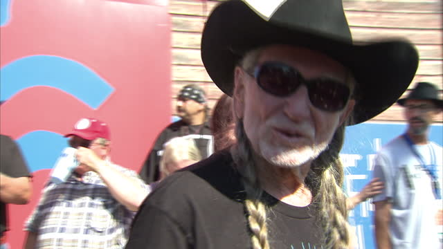 exterior shots of neil young at a benefit concert in protest at the planned keystone xl oil pipeline, and a short interview quote with willie nelson,... - willie nelson stock-videos und b-roll-filmmaterial