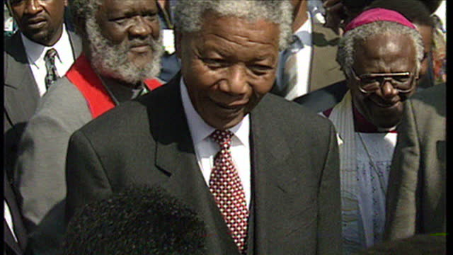 stockvideo's en b-roll-footage met exterior shots of nelson mandela and archbishop desmond tutu greeting people at an anc victory celebration rally at the fnb stadium on may 02 1994 in... - 1994