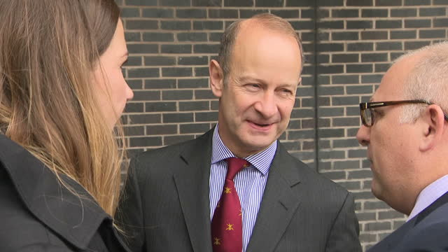 Exterior shots of new UKIP leader Henry Bolton posing for photos as antiUKIP protesters chant 'Hate No Compassion Yes' holding banners outside the...