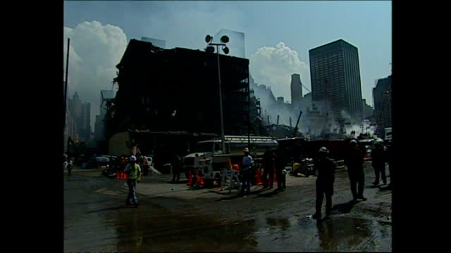 exterior shots of new york mayor rudolph giuliani touring the world trade centre site with politicians and media on september 24 2001 in new york city - petronas twin towers stock-videos und b-roll-filmmaterial