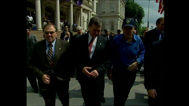 exterior shots of new york mayor rudolph giuliani walking from city hall with others for a tour of ground zero on september 24, 2001 in new york city. - town hall government building stock videos & royalty-free footage