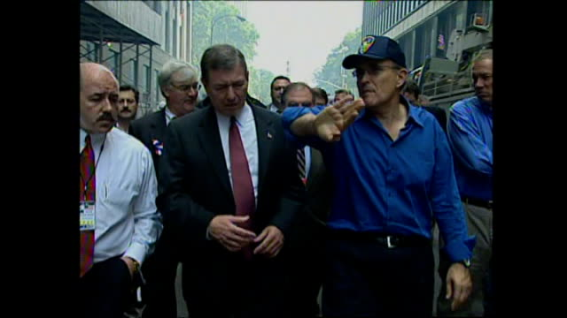 stockvideo's en b-roll-footage met exterior shots of new york mayor rudolph giuliani walking towards ground zero with politicians and members of the press on september 24, 2001 in new... - petronas twin towers
