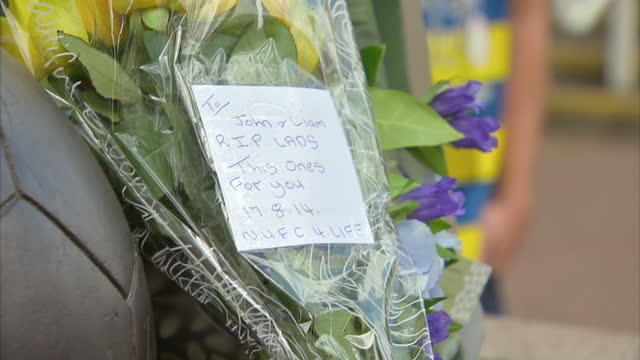 exterior shots of newcastle united football fans arriving at st james' park and a bouquet of flowers with a note paying tribute to liam sweeney and... - st. james' park newcastle upon tyne stock videos & royalty-free footage