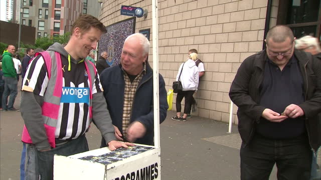 exterior shots of newcastle united football fans outside the club's st james' park stadium browsing merchandise in the club's official shop buying... - st. james' park newcastle upon tyne stock videos & royalty-free footage