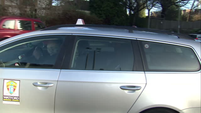 exterior shots of nicholas anelka exiting watford railway station and get into a taxi cab to take him to fa hearing on february 26 2014 in watford... - ハートフォードシャー点の映像素材/bロール