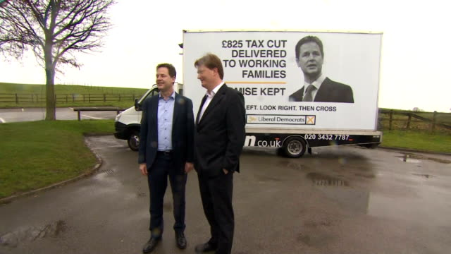 exterior shots of nick clegg and danny alexander posing fro photo op at poster launch. on april 03, 2015 in hazlemere, united kingdom. - british liberal democratic party stock videos & royalty-free footage