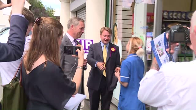 exterior shots of nigel farage campaigning for ukip uk independence party in the general election and chatting to members of the public including an... - thurrock stock videos and b-roll footage