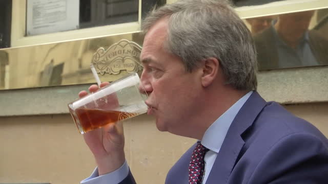 exterior shots of nigel farage, former leader of ukip drinking a pint of real ale and smoking a cigarette whilst holding theresa may's letter to... - pint glass stock videos & royalty-free footage
