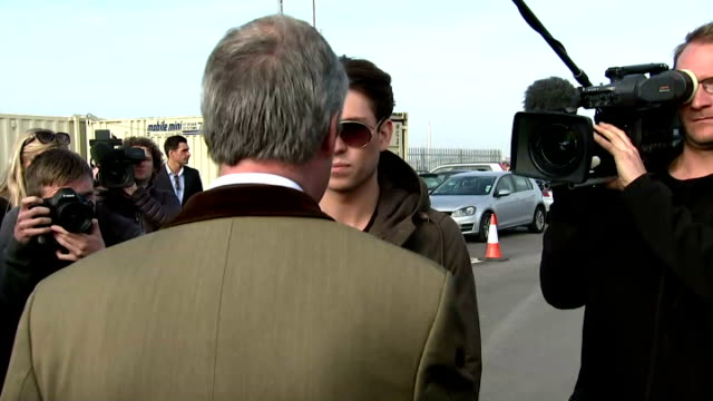 exterior shots of nigel farage ukip leader meeting joey essex reality tv star and talking about the fishing industry in grimsby on april 08 2015 in... - british liberal democratic party stock videos & royalty-free footage