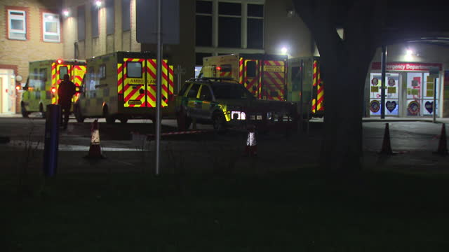 exterior shots of night time shots of southend university hospital and ambulances coming and going as essex declares major incident over virus cases... - night stock videos & royalty-free footage