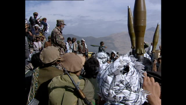 exterior shots of northern alliance recruits and soldiers gathering in jabal saraj>> on october 30 2001 in parwan province afghanistan - military recruit stock videos and b-roll footage