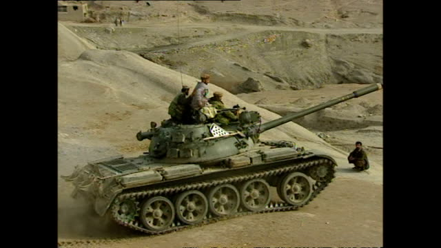 Exterior shots of Northern Alliance soldiers in the White Mountains on tanks trucks and on foot advancing on Taliban positions during the 2001 US UK...