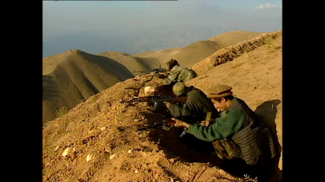 Exterior shots of Northern Alliance soldiers on hillside firing towards Taliban positions in the White Mountains on October 29 2001 in Kabul...