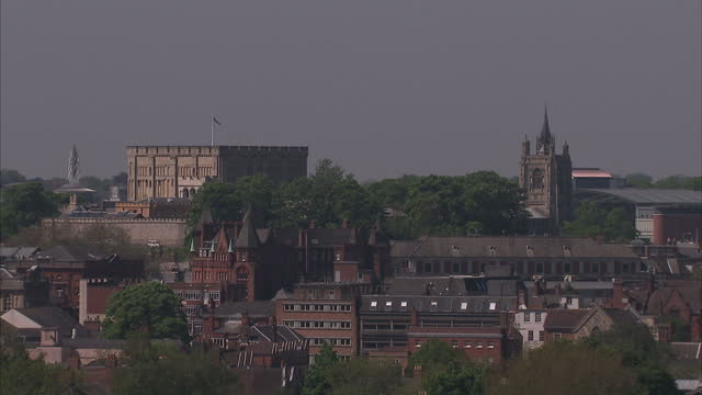 exterior shots of norwich city including churches and city hall before shots of residential houses roof tops norwich city sky line and houses on may... - norwich england bildbanksvideor och videomaterial från bakom kulisserna