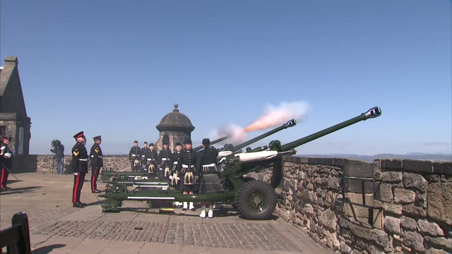 exterior shots of officer cadets from tayforth universities officer training corp fire a 21 gun salute to mark the 90th birthday of her majesty the... - 90th birthday stock videos & royalty-free footage