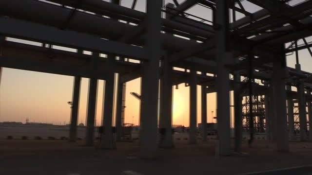 exterior shots of oil pipelines, refinery chimneys and oil workers at a ras laffan oil refinery on december 22, 2014 in ras laffan, qatar. - petrol stock videos & royalty-free footage
