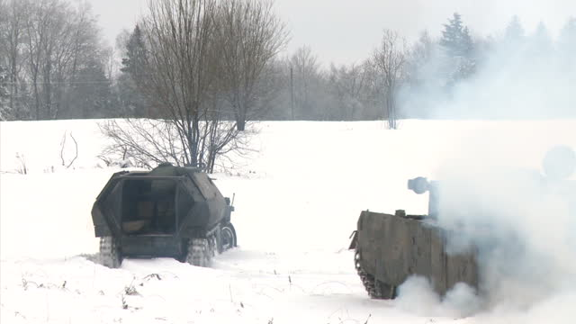 Exterior shots of old German tanks taking part in a reconstruction of a World War Two battle in the snow in Dubosekovo on December 11 2016 in...