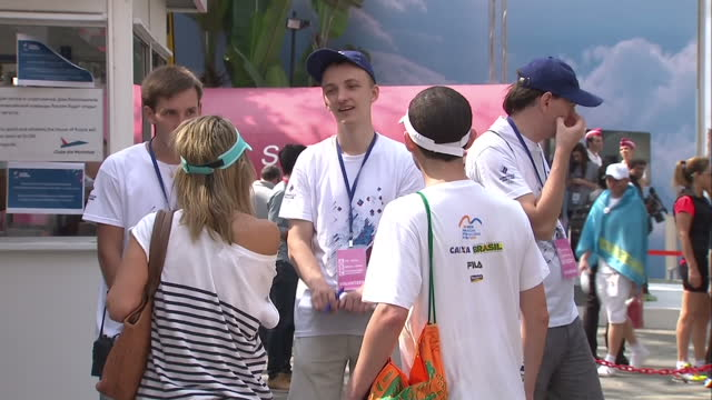 exterior shots of olympic fans next to a large 'team russia' banner on august 07 2016 in rio de janeiro brazil - ドーピング点の映像素材/bロール