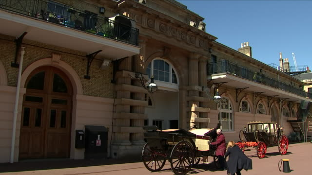 Exterior shots of open top Ascot Landau carriage and stables with horses being groomed on 2 May 2018 in Royal Mews London United Kingdom