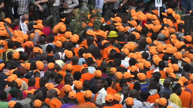 exterior shots of orangeclad supporters of raila odinga's odm party listening to an election rally speech on 25 october 2017 in nairobi kenya - raila odinga stock videos and b-roll footage