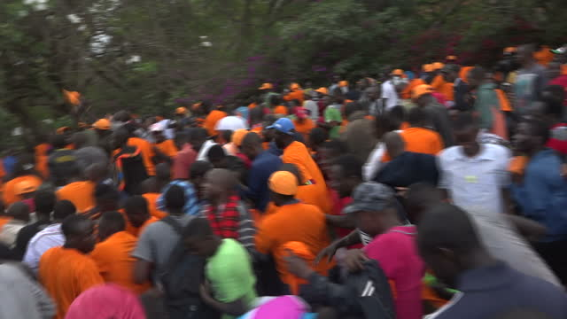 exterior shots of orangeclad supporters of raila odinga's odm party singing and dancing in a peaceful demonstration on 25 october 2017 in nairobi... - raila odinga stock videos and b-roll footage