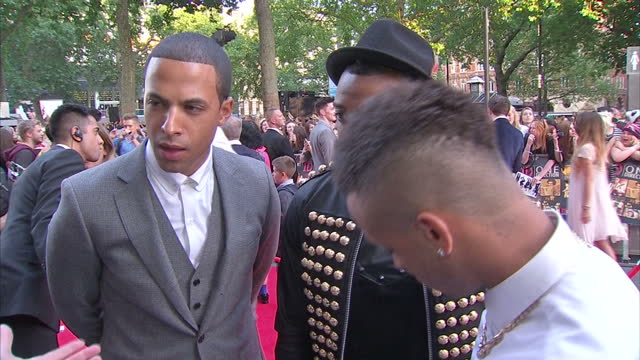 Exterior shots of Oritse Williams Marvin Humes Aston Merrygold boy band JLS giving an interview on the red carpet at the premiere of This Is Us on...