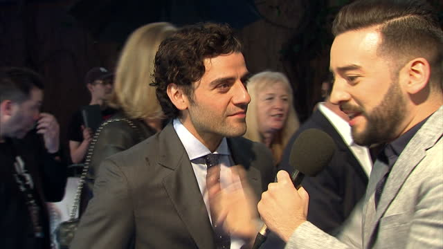 Exterior shots of Oscar Isaac actress talking with reporters on red carpet at the premiere of X Men Apocalypse on May 09 2016 in London England