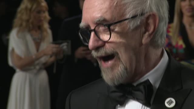 exterior shots of oscar nominee actor jonathan pryce duiring an interview at the 26th annual vanity fair oscar party at the wallis annenberg center... - oscar party stock videos & royalty-free footage