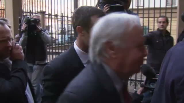 exterior shots of oscar pistorius arriving at court >> on august 08 2014 in pretoria south africa - ピストリウス恋人射殺事件点の映像素材/bロール