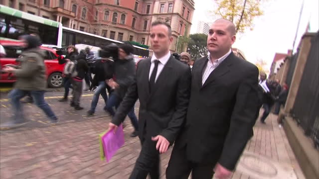 exterior shots of oscar pistorius walking from court to cafe on june 13 2016 in pretoria south africa paralympian oscar pistorius will face... - ピストリウス恋人射殺事件点の映像素材/bロール
