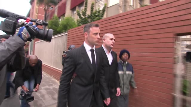 exterior shots of oscar pistorius walking from court to coffee shop and sit in coffee shop with friends and legal team on june 13 2016 in pretoria... - オスカー・ピストリウス点の映像素材/bロール