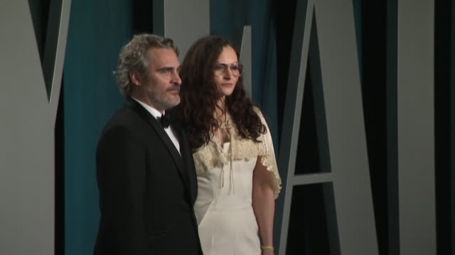 exterior shots of oscar winner joaquin phoenix and his sister rain phoenix posing for press at the 26th annual vanity fair oscar party at the wallis... - oscar party stock videos & royalty-free footage