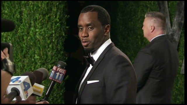 exterior shots of p diddy arriving at vanity fair oscars after party p diddy arrives at vanity fair party on february 27 2012 in los angeles... - vanity fair stock videos and b-roll footage