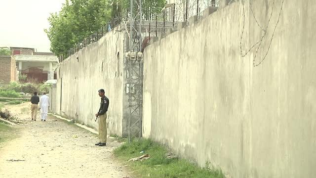 Exterior shots of Pakistani police guarding the hideout villa of AlQaeda leader Osama Bin Laden in Abbottabad Exterior shots of padlocks on gate...
