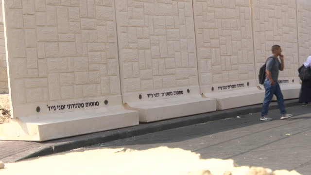 exterior shots of palestinian people in the jabel mukaber area of east jerusalem walking past a ramshackle dividing fence on october 19 2015 in... - east jerusalem stock videos & royalty-free footage