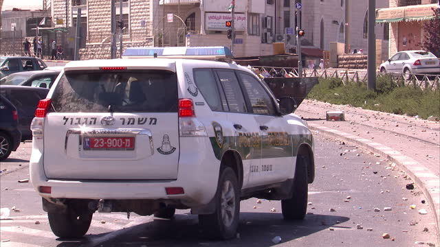 exterior shots of palestinian youths in an east jerusalem street throwing rocks towards israeli police in the street who retaliate by firing stun... - east jerusalem stock videos and b-roll footage