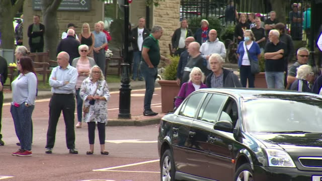 exterior shots of pallbearers carring the coffin of jack charlton into church and mourners stood outside on 22 july 2020 in ashington northumberland... - jack charlton stock videos & royalty-free footage