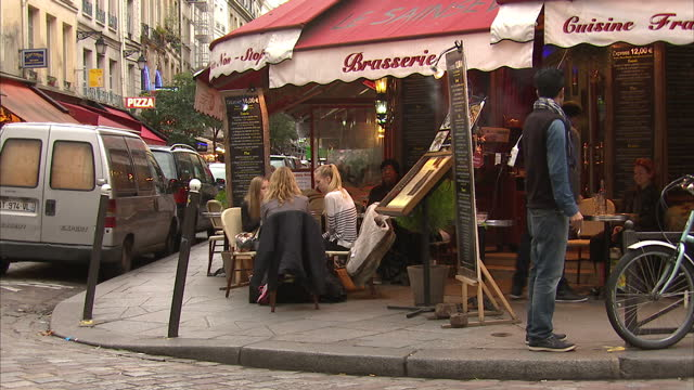 exterior shots of parisians outside pavement cafes sipping drinks and chatting in the wake of the paris terror attacks on november 17 2015 in paris... - pavement cafe stock videos & royalty-free footage