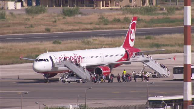 exterior shots of passengers boarding an air berlin plane at corfu airport on may 23 2015 in corfu greece - flugpassagier stock-videos und b-roll-filmmaterial