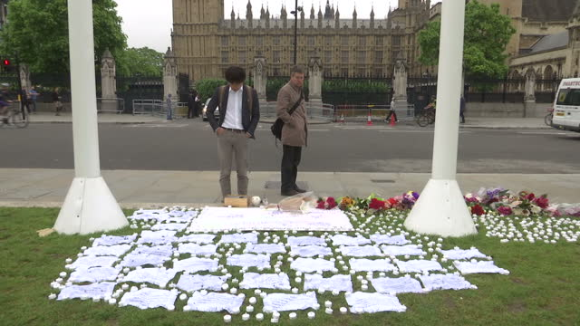 exterior shots of passers by stopping to look at tribute messages for jo cox mp who was killed in her constituency on 16th july tribute flowers have... - jo cox politician stock videos and b-roll footage
