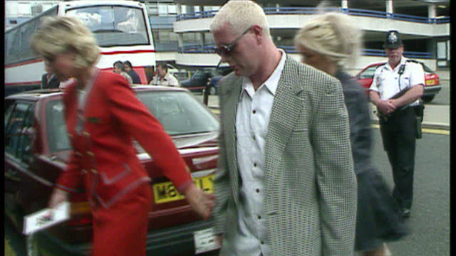exterior shots of paul gascoigne ands wife sheryl arriving at the airport with family on june 4 1998 in england - sheryl gascoigne stock videos and b-roll footage