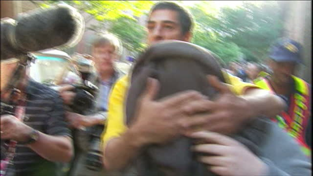 exterior shots of pavlos joseph covered with a blanket being escorted to a waiting van after his arrest for trespassing at the world cup joesph was... - trespassing stock videos & royalty-free footage