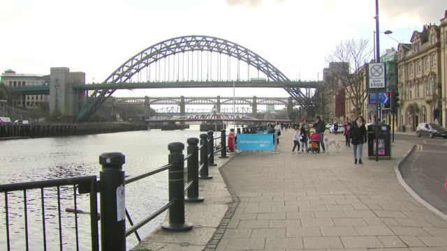 exterior shots of pedestrians walking along a street including shots of the gateshead millennium bridge in newcastle on 24th march 2018 in tyne and... - gateshead stock videos and b-roll footage