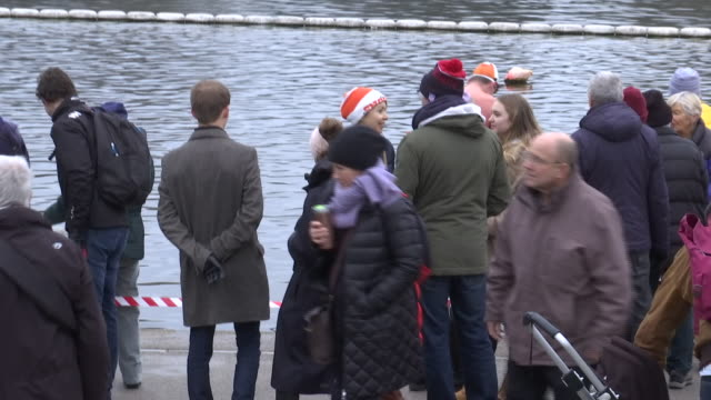 exterior shots of people and swimmers at the serpentine lake in london's hyde park after finishing the annual peter pan cup on christmas day on 25... - the serpentine london stock videos & royalty-free footage