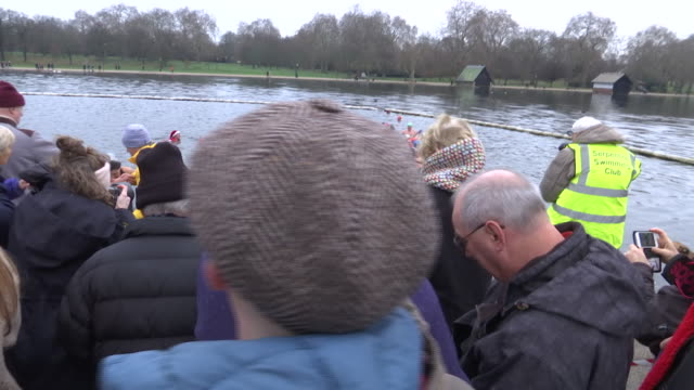 exterior shots of people applauding the swimmers at the serpentine lake in london's hyde park during the annual peter pan cup on christmas day on 25... - the serpentine london stock videos & royalty-free footage