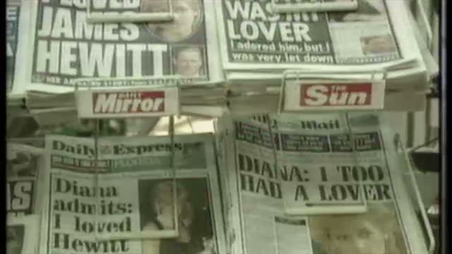 vídeos de stock, filmes e b-roll de exterior shots of people buying newspapers at victoria station newsagents newspaper headlines showing reactions to princess diana's interview on... - primeira página de jornal