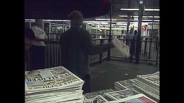 exterior shots of people buying newspapers from a kiosk in the street with newspaper headlines covering the divorce of charles and diana prince and... - newspaper stock videos & royalty-free footage